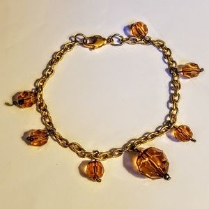 hand crafted Jewelry - Gold tone charm bracelet